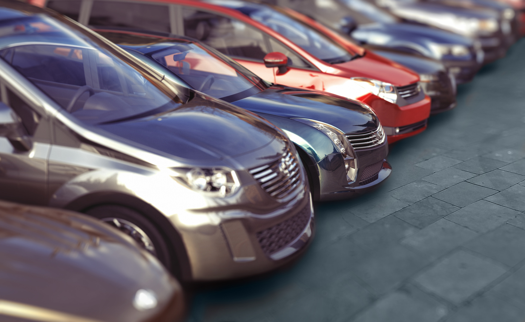 Cars in a line at a dealership